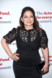 Gloria Estefan accessorized with a cute fur clutch at the Actors Fund Gala.