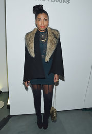 Melanie Fiona looked chic and cool in a fur-trimmed cape at The Amory Party at MOMA in NYC.