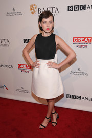Millie Bobby Brown kept it sweet at the BAFTA tea party in a black-and-white Kate Spade dress adorned with a big bow at the back.