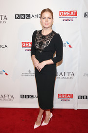Amy Adams kept it demure at the BAFTA tea party in a Dolce & Gabbana LBD with lace bib detailing.