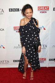 Thandie Newton showed off her unique style with this draped one-shoulder polka-dot dress by Monse at the BAFTA tea party.