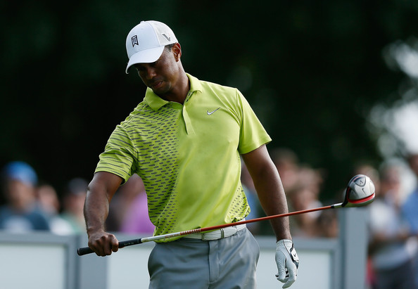 A lime green polo added a bit of unexpected color to Tiger Woods' look at The Barclays.
