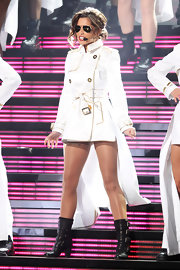 Cheryl Cole set the stage on fire with her awesome performance, but her multi-bucked boots could not be ignored.