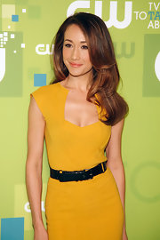 Maggie Q styled her hair in soft waves for the CW Network Upfront event.