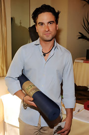 Johnny Galecki sports an earthy wooden beaded bracelet while collecting his Emmy swag.