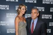 Stacy Keibler and  George Clooney (R) attend 'The Descendants' Paris Premiere at Cinema UGC Normandie on October 18, 2011 in Paris, France.