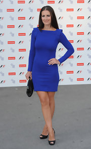 Kristy paired her peep toe pumps with a long sleeve cobalt blue dress.We love the embellished shoulders.
