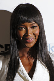 Naomi Campbell wore her hair sleek straight with blunt bangs during the launch of 'The Face.'