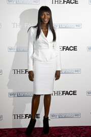 Naomi Campbell looked impeccable in a crisp white skirt suit during the launch of 'The Face.'