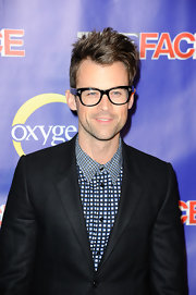Brad Goreski showed off his style with a blue patterned button-down top.