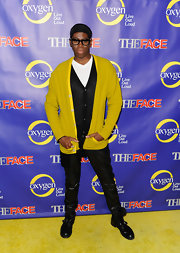 Miss J. Alexander struck a pose in this bright yellow cardigan at 'The Face' series premiere.