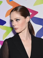 Coco Rocha slicked her hair back into a neat ponytail for the Game of Plenti event.
