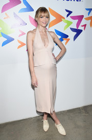 Jaime King flaunted her sexy pregnancy style with this plunging nude Calvin Klein halter dress at the Game of Plenti event.