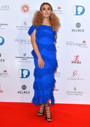 Tallia Storm donned an electric-blue cold-shoulder ruffle dress by PPQ for her Global Gift Gala look.