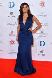 Eva Longoria looked tres chic at the Global Gift Gala in a blue Victoria Beckham gown with a deep-V neckline and a bowed waist.