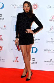 Louise Hazel cut a bold silhouette in this black velvet-burnout mini dress during the Global Gift Gala.