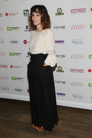 Parker Posey paired a long black skirt with a crochet-panel blouse for a boho feel during the Inaugural Hope North Gala.