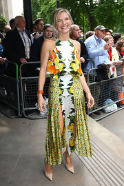 Jo Whiley balanced her summery citrus print dress with nude pointy pumps.