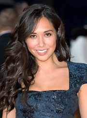 Myleene Klass wore her long hair in a cascade of curls to 'The Lion Kin 3D' premiere. To recreate her lovely style, set dry hair in hot rollers. To relax the curls slightly, brush tresses with a natural bristle brush, then make a messy  part. Smooth the hair on the top of the head, tousle ends lightly and spritz with a medium-hold hairspray.