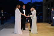 Melania Trump looked perfectly polished in an embellished white silk caftan by J. Mendel while attending a state banquet at the Imperial Palace in Tokyo, Japan.