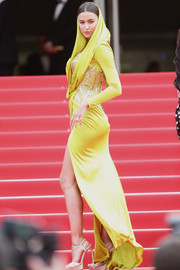 Irina Shayk looked very exotic in a hooded chartreuse Atelier Versace gown during the premiere of 'The Search.'