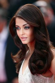 Aishwarya Rai was flawlessly coiffed with a long side-parted 'do that was sleek up top and curly down the ends during the premiere of 'The Search.'