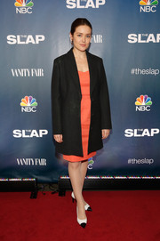 Megan Boone layered a black boyfriend coat over a coral dress for the premiere of 'The Slap.'