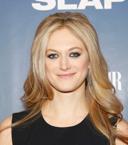 Marin Ireland went for retro charm with this feathered flip at the premiere of 'The Slap.'