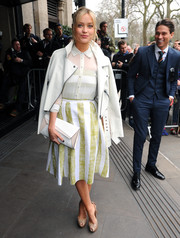 Laura Whitmore toted a white and cream clutch at the TRIC Awards in London.