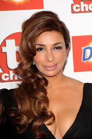 Shobna illuminated her dark brown eyes with a wash of sky blue shimmery shadow. Lashings of mascara completed the look.