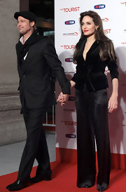 Angelina wears a sophisticated tie waist velvet blazer with sleek satin pants.