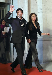 Angelina graces the red carpet in long black silk slacks.