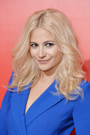 Pixie Lott wore her hair in teased waves at the 'Voice Kids' photocall.