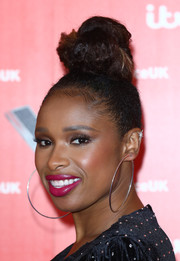 Jennifer Hudson pulled her hair up into a towering top knot for the 'Voice' UK 2019 photocall.