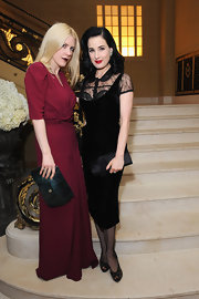 Dita Von Teese can work velvet like no other! We're dying for this lace-clad number.