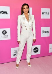 Eva Longoria chose a white tuxedo jumpsuit by Balmain for TheWrap's Power Women Summit 2019.