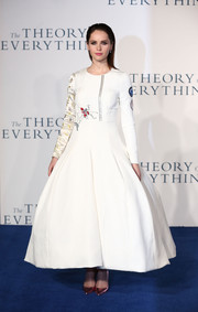 Felicity Jones looked opulent at the London premiere of 'The Theory of Everything' in a white Christian Dior Couture dress with a dramatically voluminous skirt and an embroidered bodice and sleeves.