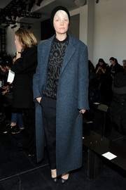 Kate Lanphear bundled up in style with a blue wool coat and an animal-print sweater during the Theory fashion show.