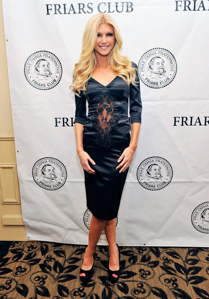 Brande Roderick kept her look classy but sexy with a navy satin dress with a lace cutout.