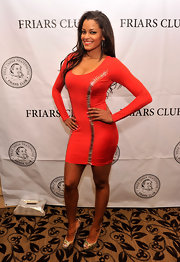 Claudia Jordan opted for a long-sleeve, red cocktail dress with silver stitch embellishments for a fun and sexy evening look.