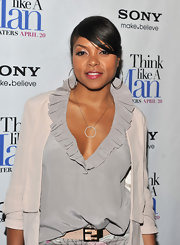 Taraji paired her floral pants with this ruffled blouse at the 'Think Like a Man' premiere.
