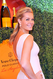 Rebecca flashed a big smile with her hair in this voluminous ponytail at the Polo Classic in LA.