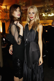 Elettra Wiedemann attended the Thomas Sabo launch party carrying a sophisticated beaded black purse.