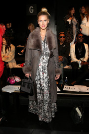Nicky Hilton showed off her posh style with this gray suede and fur coat layered over a printed maxi dress at the Thomas Wylde fashion show.