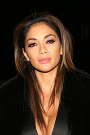 Nicole Scherzinger wore her hair loose with trendy layers at the Thomas Wylde fashion show.