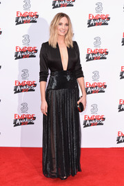 Joanne Froggatt took a daring plunge in a black top with a down-to-the navel neckline during the Three Empire Awards.