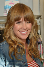 Sarah Wright's nude lips kept her beauty look casual and minimal.