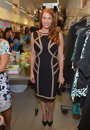 Amanda Righetti chose a black dress with tan abstract designs for her look at the Milky! launch party in Beverly Hills.
