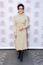 Sandra Oh looked adorable in a nude polka-dot dess with a smocked waist and neckline at the Tibet House benefit gala.