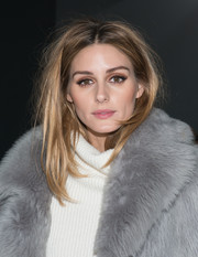 Olivia Palermo looked gorgeous at the Tibi fashion show even with this messy hairstyle.